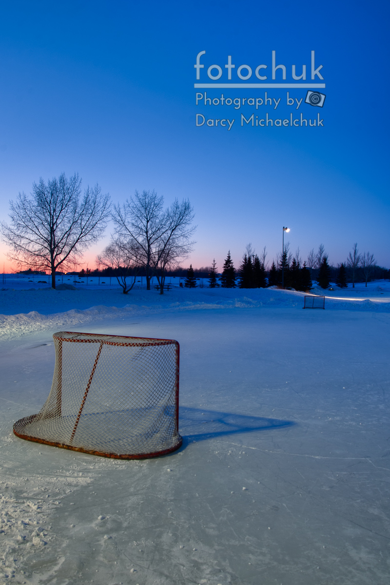 sunset with vacant pond hockey rink