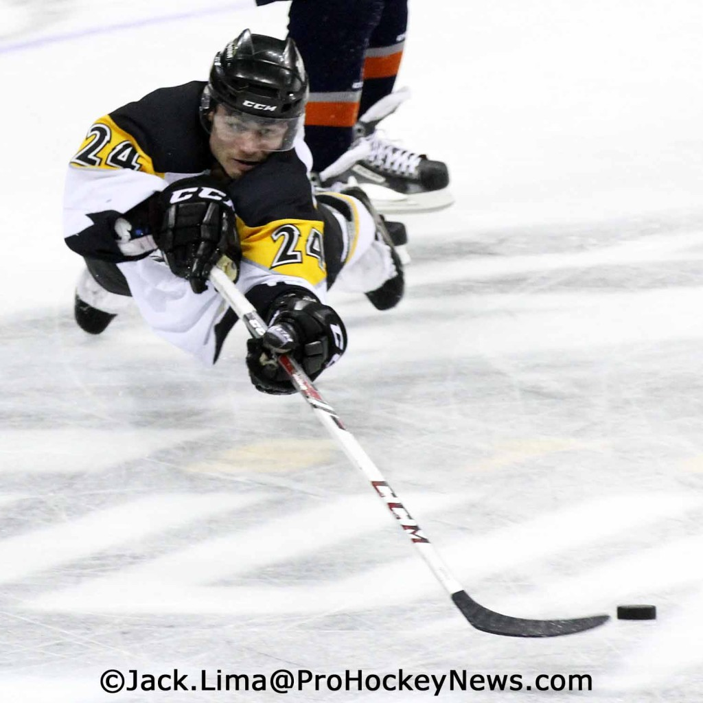 Garet Hunt Dives For The Puck