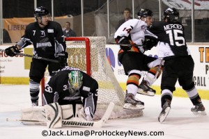 Justin-Mercier-Checks-Luke-Judson-After-Goalie-Josh-Robinson-Makes-The-Save-525x350