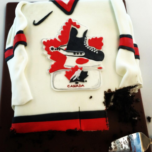 Celebrating early? Delegates at Hockey Canada's 95th AGM enjoy a red and white cake as the organization launches its centennial anniversary celebrations.