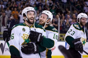 Caption: Dallas Stars teammates celebrate a win following Game 7 of the AHL Western Conference Semifinals on June 3, 2014 at Cedar Park Center, TX