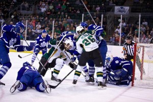 Caption: A battle beside the net as the Stars dominate Game 7 of the AHL Western Conference Semifinals on June 3, 2014 at Cedar Park Center, TX