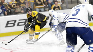 A screencap showing NHL 15 cover star Patrice Bergeron on the ice, courtesy of EA Sports