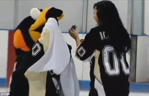 Iceburgh hid the engagement ring in his beak.