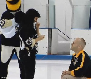 Penguins fan and local cop Gino on bended knee.