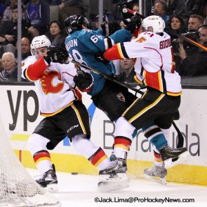 (L-R) TJ Brodie - Melker Karlsson and Mark Giordano collide behind the net (525x525)