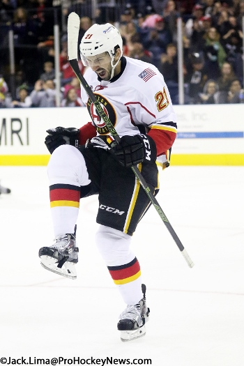 Emile Poirier celebrates his game-tying third period goal (350x525)