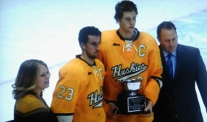 Co-Captains of the Michigan Tech Huskies, Alex Petan and Cliff Watson accept the 2nd place trophy at the 51st Annual Great Lakes Invitational