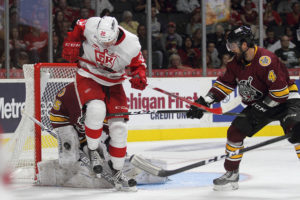 Chicago Goalie Jordan Binnington deflects a shot on goal while Morgan Ellis assists with the defense. Photo courtesy of Mark Newman, Grand Rapids Griffins